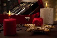 Christmas canddle gift start with box oc pralines Royalty Free Stock Image