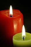 Christmas candels. Red and Green candle on black background Royalty Free Stock Photos