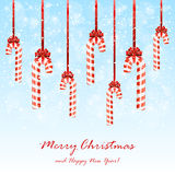 Christmas candies with bow on snowy background Royalty Free Stock Images