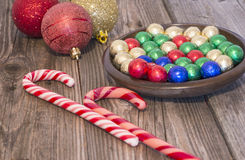 Christmas candies. Coloured Christmas candies and globes Royalty Free Stock Photo