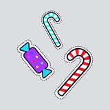 Christmas Candies. Sweet Lollipops and Bonbon. Christmas candies patch. Cut out of paper. Two sweet bent striped lollipops, blue and red. Bonbon in colourful Stock Photos