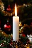 Christmas candle. Lighting before the christmas tree at Christmas Eve stock image