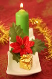 Christmas candle. And decorations on a red background Stock Photo