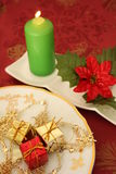 Christmas candle. And decorations on a red background Stock Photography