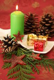 Christmas candle. And decorations on a red background Royalty Free Stock Photo
