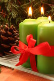 Christmas candle. Four christmas candles and decorations Stock Image