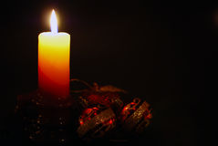 Christmas candle. Shining in the dark Royalty Free Stock Photography