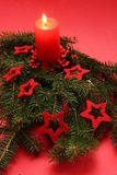 Christmas candle. On a red background Stock Photo