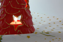 Christmas candle. In a clay candlestick Royalty Free Stock Photos