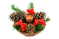 Christmas candle. Wicker basket with candle and Christmas decorations,isolated on white background Stock Photo
