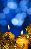 Christmas candle. With unfocused background royalty free stock images