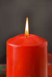 Christmas candle. A red xmas candle, a traditional symbol for Christmas Royalty Free Stock Photo