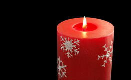 Christmas candle. Red Christmas candle isolated on black Stock Photography