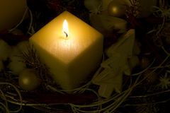 Christmas candle. Yellow candle with christmas decoration Stock Photo