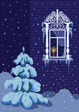 Christmas candle. On the night of Christmas a candle burns on the window sill. It is snowing Royalty Free Stock Photography