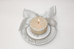 Christmas candle. Metallic christmas candle on the plate Royalty Free Stock Photos