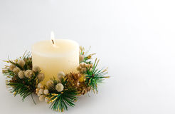 Christmas Candle. Candle with Christmas decorations, on white background Royalty Free Stock Images