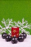 Christmas candle and balls. Red candle with black balls and space for text Stock Photos