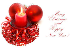 Christmas candle and balls. Stock Photos