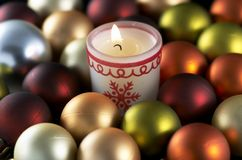 Christmas candle and balls Stock Image