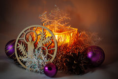 Christmas Candle. Among Christmas balls, cones, decorative ornaments from wood Royalty Free Stock Image