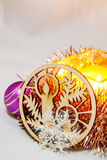 Christmas Candle. Among Christmas balls, cones, decorative ornaments from wood Royalty Free Stock Photo