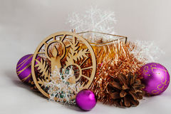 Christmas Candle. Among Christmas balls, cones, decorative ornaments from wood Stock Images