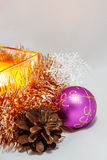 Christmas Candle. Among Christmas balls, cones, decorative ornaments from wood Royalty Free Stock Images