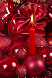 Christmas candle and balls in red tone. Stock Photography