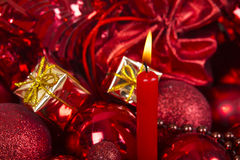 Christmas candle and balls in red tone. Royalty Free Stock Photography