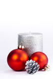 Christmas candle and baubles Stock Image