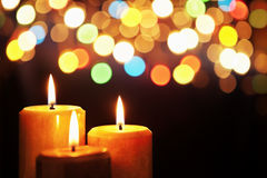 Christmas candle with blurred light Royalty Free Stock Images