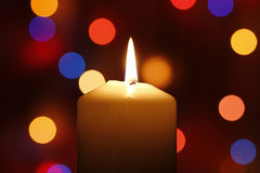 Christmas candle, with bokeh spot lights. In the background stock photography