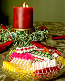 Christmas Candle and bowl of candy. Royalty Free Stock Image