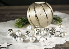 Christmas, candle with branch and silver bullets Royalty Free Stock Photos