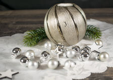 Christmas, candle with branch and silver bullets Stock Photos
