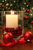 Christmas candle buring brightly royalty free stock photo