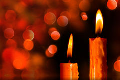 Christmas Candle. Burning In Dark And Light bokeh Royalty Free Stock Images