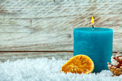 Christmas candle burning in winter snow Royalty Free Stock Image