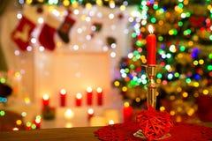 Christmas Candle in Candelabra, Candelabrum over Defocused Room. Lights Background Royalty Free Stock Images