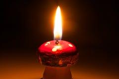 Christmas candle - Candle light. Mushroom candle on dark background Stock Photography