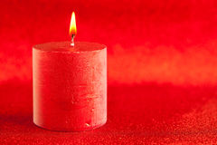 Christmas candle candlelight on red glitter Royalty Free Stock Images