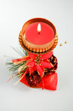 Christmas candle in a candlestick. With a festive decor Royalty Free Stock Image