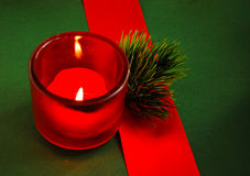 Christmas candle in a candlestick. With a festive decor Royalty Free Stock Images