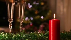 Christmas Candle and champagne glasses stock video footage