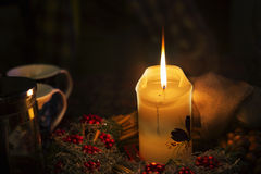 Christmas candle on a Christmas table Stock Images