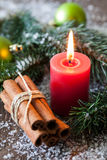 Christmas candle and cinnamon Stock Photography