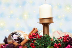 Christmas Candle with cinnamon and balls Stock Photo