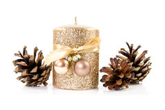 Christmas  candle  and cones Stock Photos