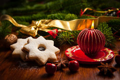 Christmas candle with cookies Stock Photo